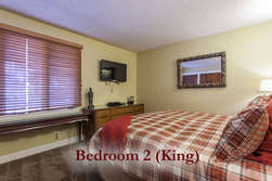Downstairs- spacious Master with King size bed. Private bath across the hall.