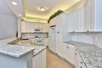 Fully Stocked Kitchen Area;