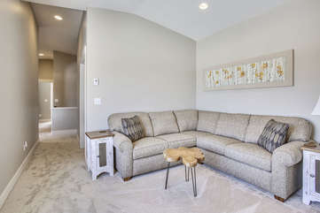Upper loft area with large custom sectional.