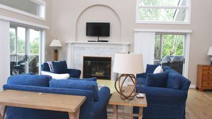 The open living area has transom windows allowing sunlight to stream.