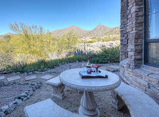 Outside table with views of mountains and desert vegetation