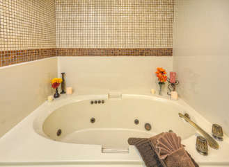 Ease sore muscles and fatigue by soaking in luxurious whirlpool tub in north master pool side suite