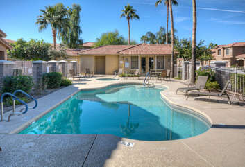 Heated community pool and hot tub are nearby for refreshing year-round dips