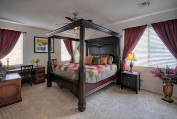 Master bedroom with king canopy bed is upstairs