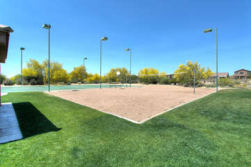 Community volleyball and basketball courts for guests to use