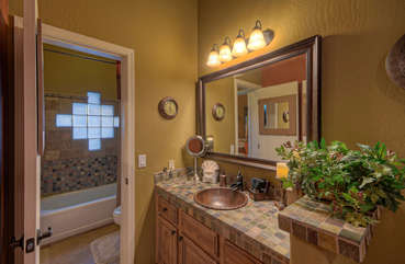 Second bath is Jack and Jill design with stylish vanities on both sides
