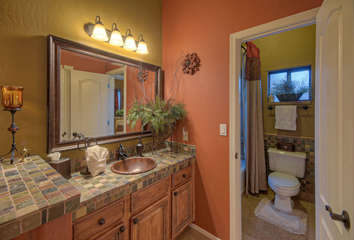Tub/shower combination in Jack and Jil bathroom shared between second and third bedrooms