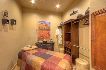 Walk-in closet in master suite doubles as a massage room