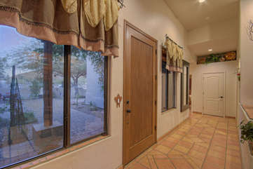 Foyer with large windows provides cheerful entrance to home