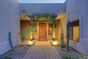 Custom-built and charming entrance way greets you
