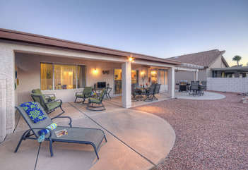 Covered patio with grill is perfect spot to celebrate your time in warm and sunny Arizona