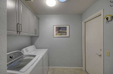 Separate laundry room has family size washer and dryer to keep your wardrobe ready to go