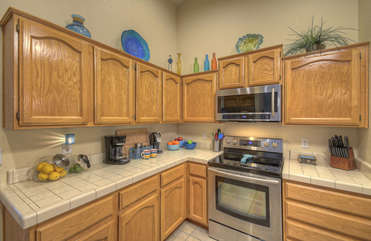 Stylish kitchen features new cabinets and counters (not shown) new stainless steel appliances. Chefs are welcome!