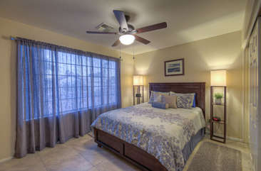 Third bedroom also has deluxe queen bed and large windows with outdoor view