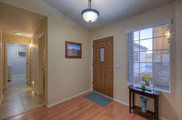 Step into entrance foyer and fall in love with delightful, single story home