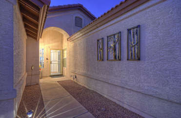 Custom entrance welcomes you to lovely home with appreciative amenities