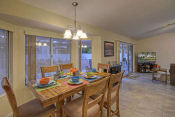 Dining area for 6 with outdoor view from many large windows