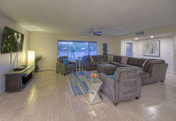 Well appointed great room is arranged for relaxing, watching TV or viewing backyard festivities