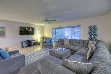 Spacious great room has large sectional sofa with chaise so all guests have a comfortable seat and view of television