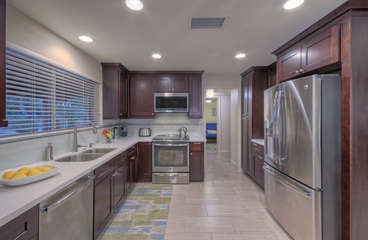 The chef or chefs will love working in custom kitchen with plentiful workspace, beautiful cabinets and enticing view of the outdoors