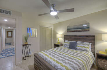 Fourth bedroom features queen bed and TV (not shown in photo)