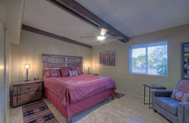 King bed and TV are appreciable features in east master bedroom
