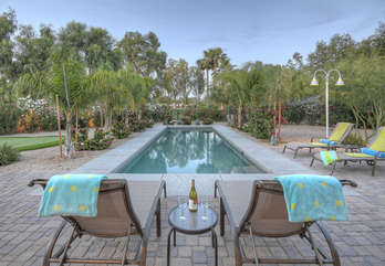 Sparkling pool with comfie lounge chairs for appreciating the amazing view of Starfire Golf Course