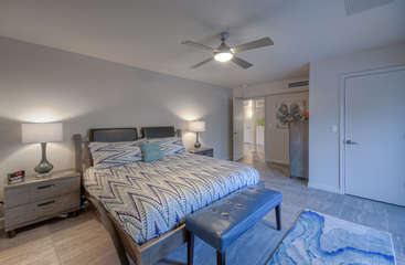 At the opposite end of home from west master suite is east master suite with king bed and walk-in closet