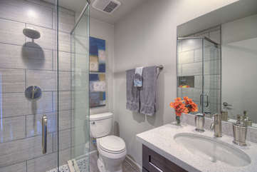 Remodeled east master suite includes walk-in glass shower