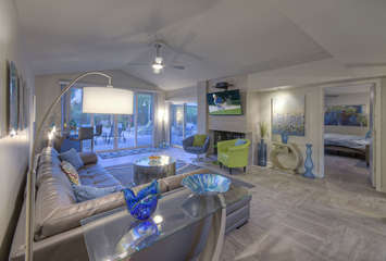 Large TV, fireplace and plush sectional sofa make great room a popular place to hang out with your favorite people