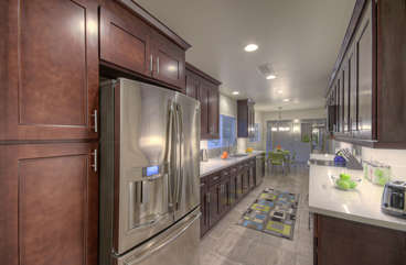 Beautiful designer kitchen is completely stocked so preparing and serving your favorite drinks and cuisine is efficient