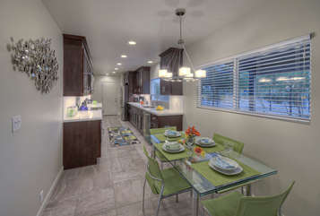 Eating area and attractive outdoor views are appealing qualities of spacious kitchen