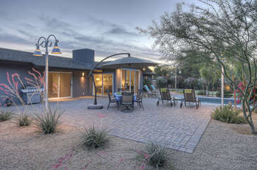 Large back patio has gas grill and dining furniture so you can enjoy eating outdoors year-round