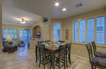 Open floor plan, vaulted ceilings and large bright windows enhance home's ambiance