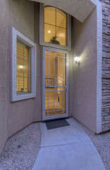 Home's private and stylish front entrance is on side of unit