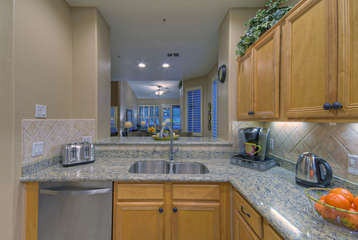 Wow! Look how kitchen sparkles with new granite counter tops and stainless steel appliances!