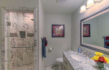 Bath in south master mountain view suite has new custom tile in walk-in shower and attractive new vanity