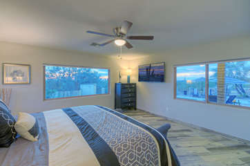 Large windows in south master pool view suite offer impressive views of pool and beyond