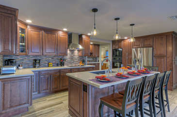 Custom kitchen has brand new cabinets, quartz counters and several new appliances