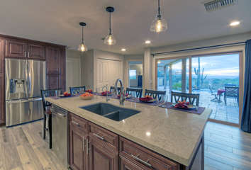 Custom kitchen with bar seating has spectacular scenic views so don't be surprised if the chef is distracted and meals are late