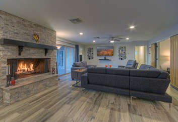 Gather in stylish great room to relax, watch TV and be warmed by newly redone wood-burning fireplace