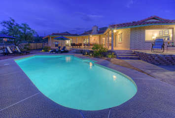 Private pool with option to heat is one of many enticing amenities that make this home a premium retreat