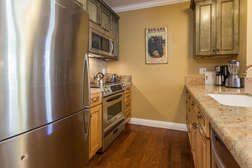 Fully Equipped Kitchen with Stainless Steel appliances and Granite counter-tops.
