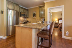 Fully Equipped Kitchen with Stainless Steel appliances and Granite counter-tops, bar stools for two