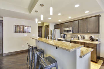 Granite Counter Top and Modern Bar Stools