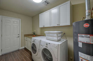 Separate laundry room with new washer and dryer
