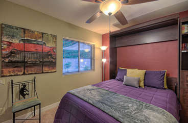 Third bedroom with queen Murphy bed is adjacent to great room and has view of pool