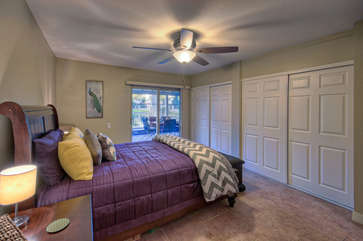 Closet space and lake views are impressive features of comfortable master bedroom