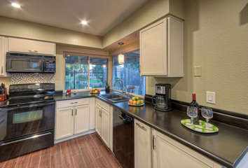 Kitchen is completely stocked for preparing and serving favorite meals and drinks