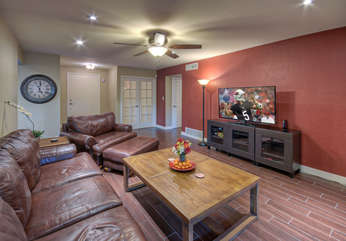 Great room is wonderful gathering area to enjoy TV and gas fireplace